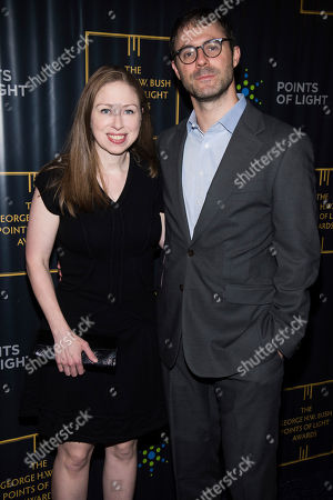Stock Image of Chelsea Clinton, Marc Mezvinsky. Chelsea Clinton and Marc Mezvinsky attend the George H.W. Bush Points of Light Awards Gala at the Intrepid Sea, Air & Space Museum, in New York
