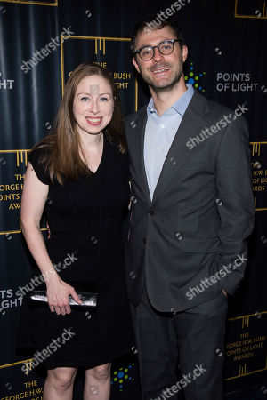 Stock Photo of Chelsea Clinton, Marc Mezvinsky. Chelsea Clinton and Marc Mezvinsky attend the George H.W. Bush Points of Light Awards Gala at the Intrepid Sea, Air & Space Museum, in New York