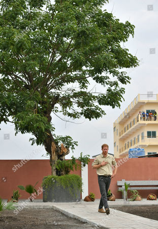 Prince Harry walks by the Diana Tree in Huambo, Angola, on day five of the royal tour of Africa. The Duke is visiting the minefield where his late mother, the Princess of Wales, was photographed in 1997, which is now a busy street with schools, shops and houses.