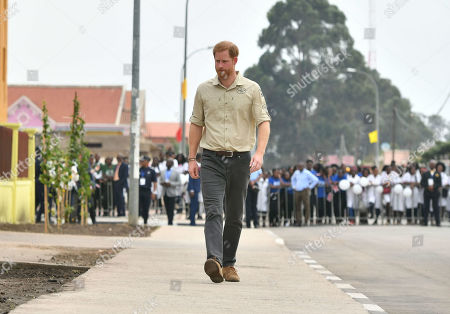 Prince Harry walks on Princess Diana Street in Huambo, Angola, on day five of the royal tour of Africa. The Duke is visiting the minefield where his late mother, the Princess of Wales, was photographed in 1997, which is now a busy street with schools, shops and houses.