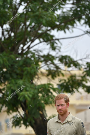 Prince Harry in front of the Diana Tree in Huambo, Angola, on day five of the royal tour of Africa. The Duke is visiting the minefield where his late mother, the Princess of Wales, was photographed in 1997, which is now a busy street with schools, shops and houses.