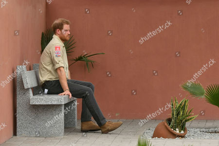 Prince Harry sits alone beneath the Diana Tree in Huambo, Angola, on day five of the royal tour of Africa. The Duke is visiting the minefield where his late mother, the Princess of Wales, was photographed in 1997, which is now a busy street with schools, shops and houses.
