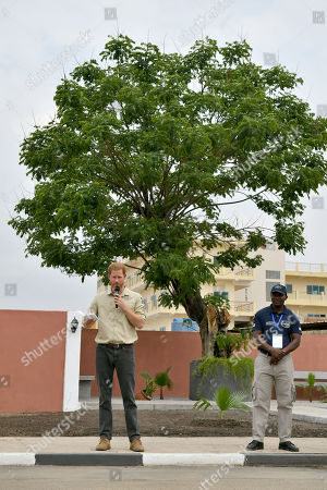Stock Photo of Prince Harry delivers a speech in front of the Diana Tree in Huambo, Angola, on day five of the royal tour of Africa. The Duke is visiting the minefield where his late mother, the Princess of Wales, was photographed in 1997, which is now a busy street with schools, shops and houses.