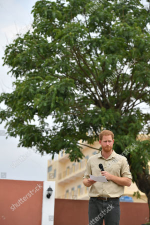 Prince Harry delivers a speech in front of the Diana Tree in Huambo, Angola, on day five of the royal tour of Africa. The Duke is visiting the minefield where his late mother, the Princess of Wales, was photographed in 1997, which is now a busy street with schools, shops and houses.