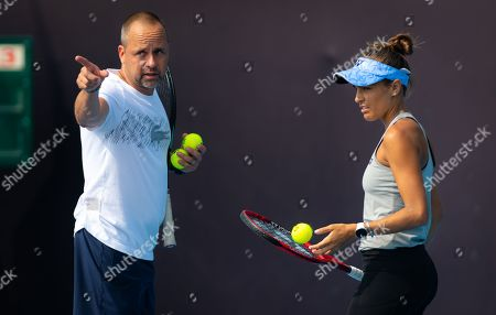 Monica Puig of Puerto Rico and coach Philippe Dehaes during practice at the 2019 China Open Premier Mandatory tennis tournament