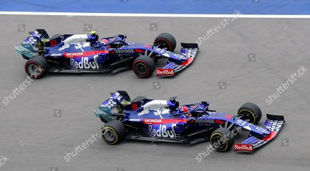 French Formula One driver Pierre Gasly of Scuderia Toro Rosso (L) and Russian Formula One driver Daniil Kvyat of Scuderia Toro Rosso (R) in action during the second practice session at the Formula One Grand Prix of Russia at the Sochi Autodrom circuit, in Sochi, Russia, 27 September 2019. The Formula One Grand Prix of Russia will take place on 29 September 2019.