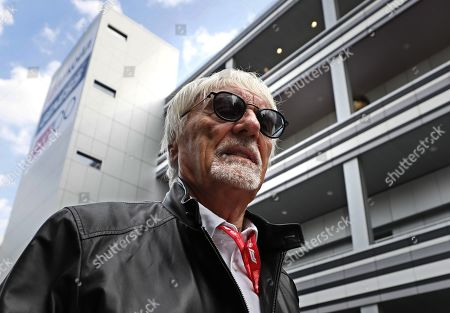 Former Formula One chairman Bernie Ecclestone arrives at the in the pit lane during first practice session at the Formula One Grand Prix of Russia at the Sochi Autodrom circuit, in Sochi, Russia, 27 September 2019.