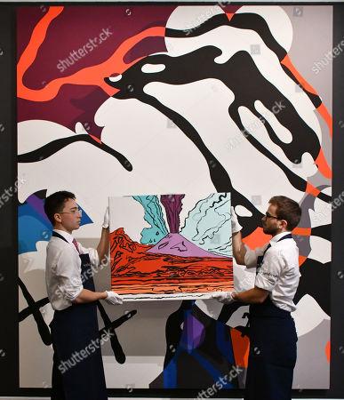 Stock Picture of (Foreground) Andy Warhol, Vesuvius, 1985, estimate, £280,000-350,000, (Background), KAWS, The Final Machine, 2015, estimate, £500,000-700,000