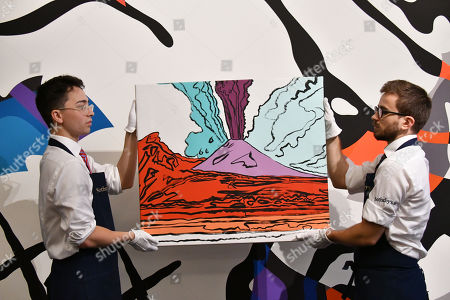 Stock Photo of (Foreground) Andy Warhol, Vesuvius, 1985, estimate, £280,000-350,000, (Background), KAWS, The Final Machine, 2015, estimate, £500,000-700,000