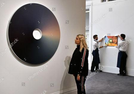 (L) Olafur Eliasson, Colour Experiment No.72, 2015, estimate, £80,000-120,000, (R) David Hockney, Bridlington Studio Interior, estimate, £900,000-1,200,000