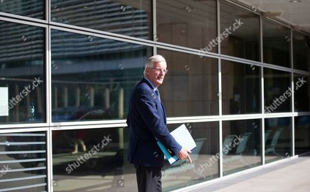 European Union chief Brexit negotiator Michel Barnier waits outside of EU headquarters in Brussels for the arrival of Irish Foreign Minister Simon Coveney, . Michel Barnier is meeting with Irish Foreign Minister Simon Coveney and UK Brexit secretary Stephen Barclay seeking a way to unblock the stalled negotiations on Britain's withdrawal from the bloc