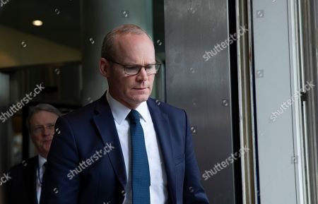 Irish Foreign Minister Simon Coveney walks out of EU headquarters in Brussels after a meeting with European Union chief Brexit negotiator Michel Barnier, . Michel Barnier is meeting with Irish Foreign Minister Simon Coveney and UK Brexit secretary Stephen Barclay seeking a way to unblock the stalled negotiations on Britain's withdrawal from the bloc