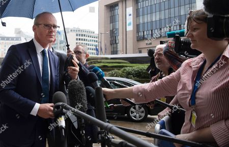 Irish Foreign Minister Simon Coveney, left, speaks with the media outside EU headquarters in Brussels after a meeting with European Union chief Brexit negotiator Michel Barnier, . Michel Barnier is meeting with Irish Foreign Minister Simon Coveney and UK Brexit secretary Stephen Barclay seeking a way to unblock the stalled negotiations on Britain's withdrawal from the bloc