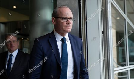 Irish Foreign Minister Simon Coveney leaves EU headquarters in Brussels after a meeting with European Union chief Brexit negotiator Michel Barnier, . Michel Barnier is meeting with Irish Foreign Minister Simon Coveney and UK Brexit secretary Stephen Barclay seeking a way to unblock the stalled negotiations on Britain's withdrawal from the bloc