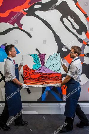 Vesuvius, 1985, by Andy Warhol, est £280-350,000 in front of The final machine, 2015, by Kaws, est £0.5-0.6m
