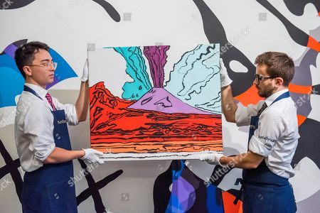 Stock Photo of Vesuvius, 1985, by Andy Warhol, est £280-350,000 in front of The final machine, 2015, by Kaws, est £0.5-0.6m