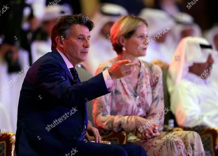 Stock Photo of IAAF president Sebastian Coe (L) of Britain and his wife Carole Annett (R) attend the opening ceremony of the IAAF World Athletics Championships 2019 in Doha, Qatar, 27 September 2019.