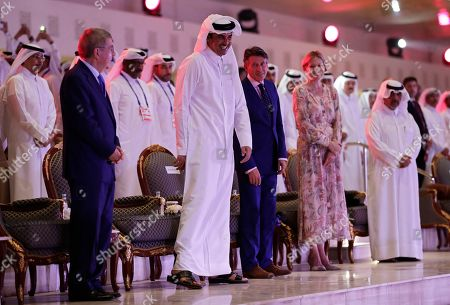 Stock Picture of (L-R) International Olympic Committee (IOC) president Thomas Bach of Germany, Sheikh Tamim bin Hamad Al Thani, Emir of Qatar, IAAF president Sebastian Coe of Britain, and Coe's wife Carole Annett attend the opening ceremony of the IAAF World Athletics Championships 2019 in Doha, Qatar, 27 September 2019.