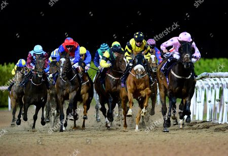 Dundalk PAK ARMY & Rory Cleary (yellow & Black) turn into the home straight to win the Dundalk Stadium Handicap from CACIQUE ROYALE & Chris Hayes (left red blue sleeves)