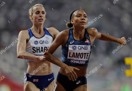 Rénelle Lamote of France, right, and Britain's Lynsey Sharp compete during the women's 800 meters heats at the World Athletics Championships in Doha, Qatar
