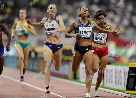 Stock Image of From right, Rababe Arafi of Morocco, Rénelle Lamote of France and Britain's Lynsey Sharp compete during the women's 800 meters heats at the World Athletics Championships in Doha, Qatar