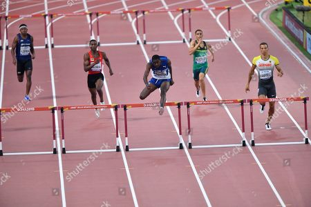 Kyron McMaster of the British Virgin Islands, center, competes with Ned Justeen Azemia of the Seychelles, left, Creve Armando Machava of Mozambique, second left, Lindsay Hanekom of South Africa, second right, and Luke Campbell of Germany, right, during the men's 400 meters hurdles heats during the World Athletics Championships, in Doha, Qatar