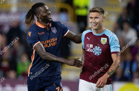 Burnley's Jeff Hendrick And Istanbul Basaksehir's Emmanuel Adebayor In The Europa League. Europa League: Burnley V Istanbul Basaksehir (1-0) Aug 16th 2018 - Burnley UK .