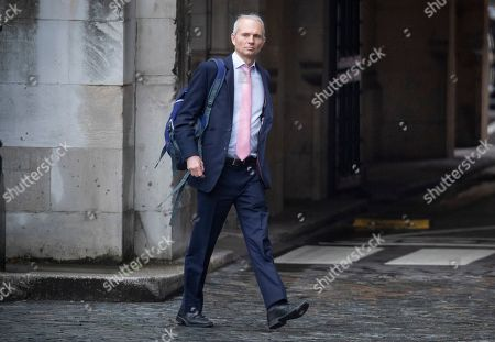 Conservative MP David Lidington walks at Parliament in Westminster