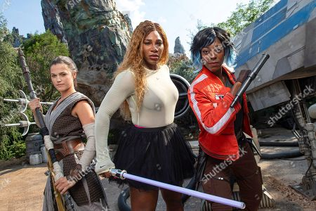 Serena Williams (centre) with Disney cast members 'Rey' (left) and 'Vi Moradi' (right).