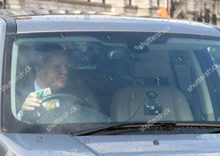 Charlie Elphicke MP driving into Parliament