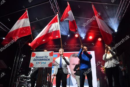 Norbert Hofer (2-L), leader of the right-wing Austrian Freedom Party (FPOe) and FPOe's Herbert Kickl (2-R) wave flags during the finale FPOe election campaign event for the Austrian federal elections in Vienna, Austria, 27 September 2019. The Austrian federal elections will take place on 29 September 2019.