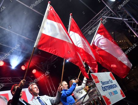 Norbert Hofer (2-L), leader of the right-wing Austrian Freedom Party (FPOe) and FPOe's Herbert Kickl (2-R) wave flags  during the final FPOe election campaign event for the Austrian federal elections in Vienna, Austria, 27 September 2019. The Austrian federal elections will take place on 29 September 2019.
