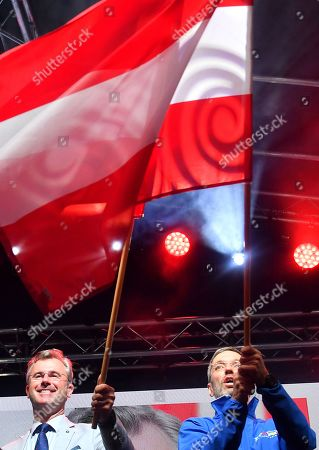 Norbert Hofer (L), leader of the right-wing Austrian Freedom Party (FPOe) and FPOe's Herbert Kickl (R) wave flags  during the final FPOe election campaign event for the Austrian federal elections in Vienna, Austria, 27 September 2019. The Austrian federal elections will take place on 29 September 2019.