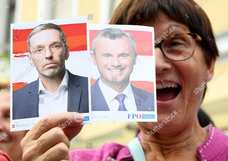 A supporter of Austrian Freedom Party (FPOe) shows photos of FPOe's Norbert Hofer and Herbert Kickl before the final FPOe election campaign event for the Austrian federal elections in Vienna, Austria, 27 September 2019. The Austrian federal elections will take place on 29 September 2019.