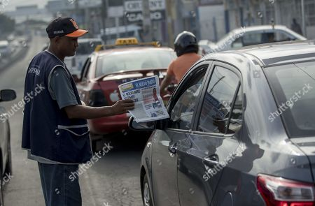 A vendor offers the latest edition of the newspaper El Nuevo Diario, whose cover reads 'El Nuevo Diario suspends publication', in Managua, Nicaragua, 27 September 2019. Nicaraguan newspapers El Nuevo Diario, Metro and Maje, critical of the government of President Daniel Ortega, stopped circulating as of Friday due to 'economic, technical and logistical difficulties', in the midst of the worst crisis in Nicaragua in the last three decades. The three newspapers, which belong to the publishing company Nuevo Amanecer and whose owners are the Promerica financial group, with Nicaraguan capital, explained in a statement that they decided to discontinue with their publications, in print and digital, because the adverse difficulties they face 'makes unsustainable functioning'.