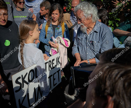 Swedish climate activist Greta Thunberg chats with Canadian environmental activist David Suzuki after her speech during a press conference at the 'Fridays For Future Summit?, in Montreal, Canada, 27 September 2019.  Millions of people across the world are taking part in demonstrations demanding action on climate issues. The Global Climate Strike Week is held from 20 September to 27 September 2019.