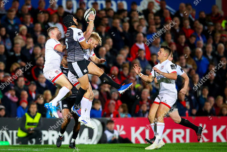 Stock Photo of Ulster vs Ospreys. Ulster's Craig Gilroy with Dan Evans of Ospreys