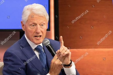 Stock Photo of Former U.S. President Bill Clinton speaks at the Bloomberg Global Business Forum in New York. Clinton and former Florida Gov. Jeb Bush are headlining an event at a Maine university where they are expected to talk about education. The event's scheduled for Friday, Sept. 27, at the University of New England's Biddeford campus