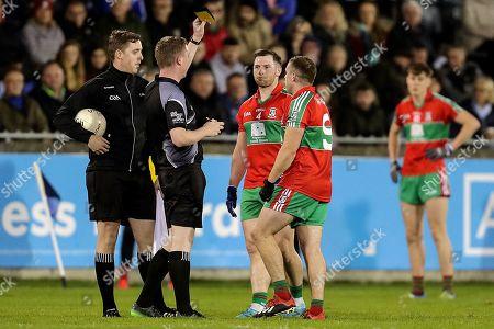 Na Fianna vs Ballymun Kickhams. Ballymun Kickhams' Philly McMahon receives a yellow card from referee Sean McCarthy