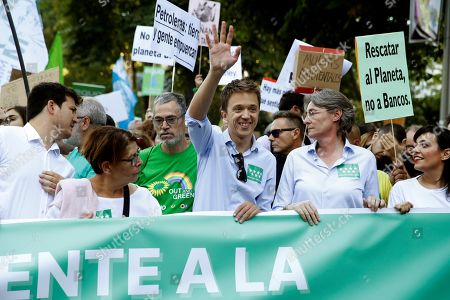 Inigo Errejon (C), leader and candidate of the recently created party Mas Pais (lit. More Country) for the next general elections, attends a rally against climate change next to party members Ines Sabanes (L) and Marta Higueras (R), in Madrid, Spain, 27 September 2019. Millions of people across the world are taking part in demonstrations demanding action on climate issues. The Global Climate Strike Week is held from 20 September to 27 September 2019.