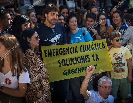 Javier Bardem joins protesters to hold a banner during the protest