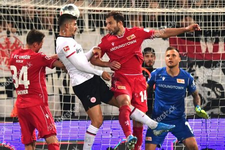 Frankfurt's Andre Silva (C) in action against Union's Ken Reichel and Christian Gentner (L) in front of Union's goalkeeper Rafal Gikiewicz during the German Bundesliga soccer match between 1. FC Union Berlin and Eintracht Frankfurt in Berlin, Germany, 27 September 2019.