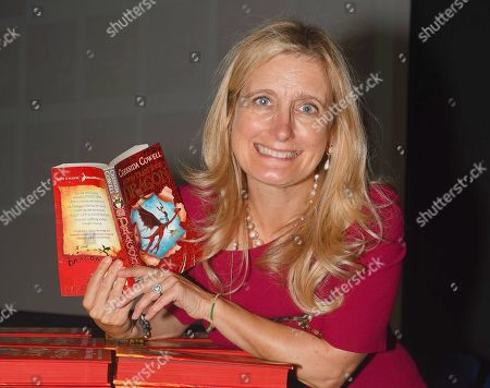 Stock Image of Cressida Cowell at Dorcan Academy reading to Liden Primary School pupils.