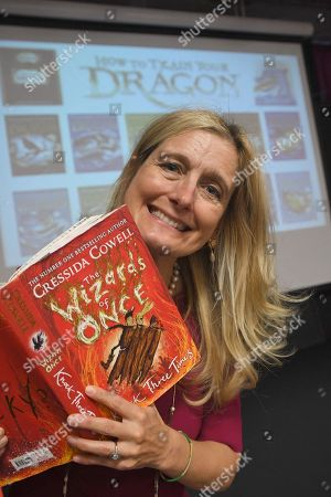 Stock Picture of Cressida Cowell at Dorcan Academy reading to Liden Primary School pupils.