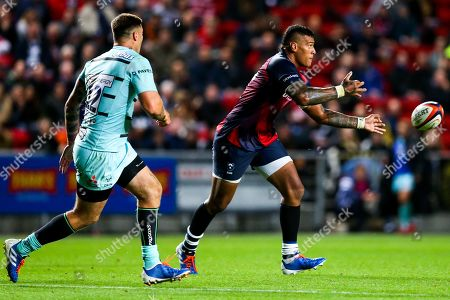 Nathan Hughes of Bristol Bears is challenged by Matt Banahan of Gloucester Rugby