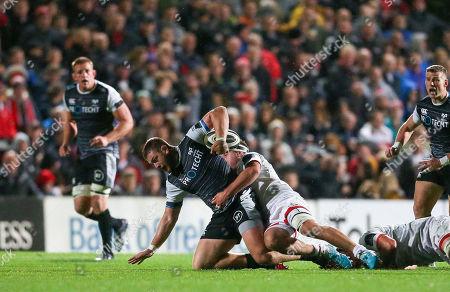 Osprey's Rhodri Jones is tackled by Ulster's Greg Jones
