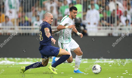 Stock Image of Al-Ahli player Omar Al-Somah (R) in action for the ball with Al -Nassr player Maicon Pereira Roque (L) during the Saudi Professional League soccer match between Al Ahli and Al Nassr at King Abdullah international stadium in Jeddah, Saudi Arabia, 27 September 2019.