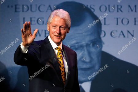 Former President Bill Clinton arrives speak at a George and Barbara Bush Distinguished Lecture series event, at the University of New England in Biddeford, Maine