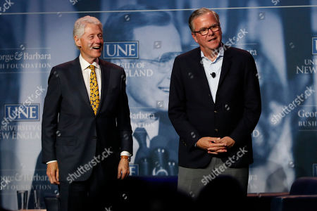 Bill Clinton, Jeb Bush. Former President Bill Clinton, left, and former Florida Gov. Jeb Bush take part in the George and Barbara Bush Distinguished Lecture series, at the University of New England in Biddeford, Maine