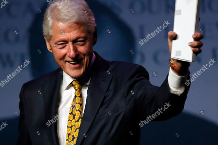Former President Bill Clinton acknowledges applause after taking part in a discussion in the George and Barbara Bush Distinguished Lecture series, at the University of New England in Biddeford, Maine